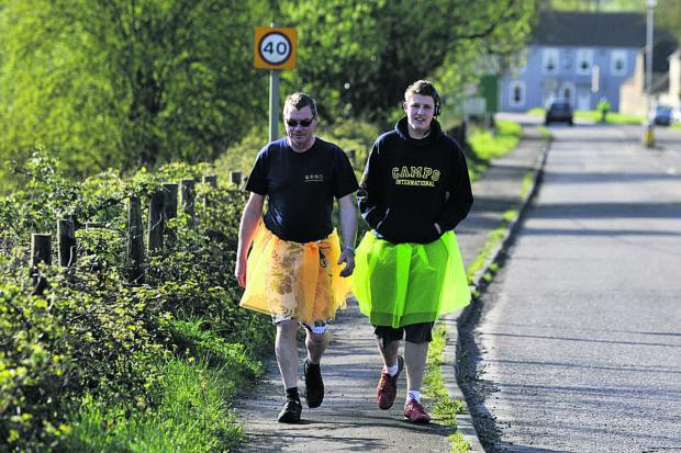 This Is Wiltshire: Jacob Blood, right, accompanied by his mum's partner Pete Gale on the alternative marathon                   (49314)