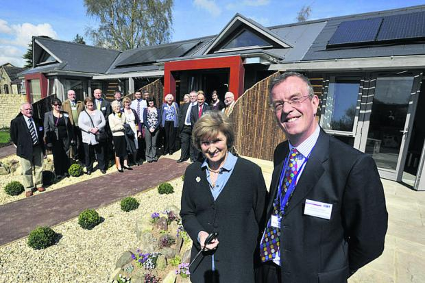 This Is Wiltshire: Dorothy House Hospice chairman Simon Coombe with Miranda, Duchess of Beaufort, who opened the new community lodges there on Friday last week                                                                                                            Photo: