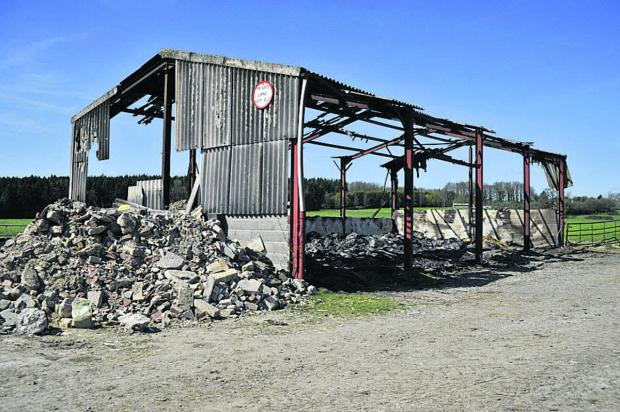 This Is Wiltshire: The burnt out frame of the barn in Warminster Photo: Glenn Phillips
