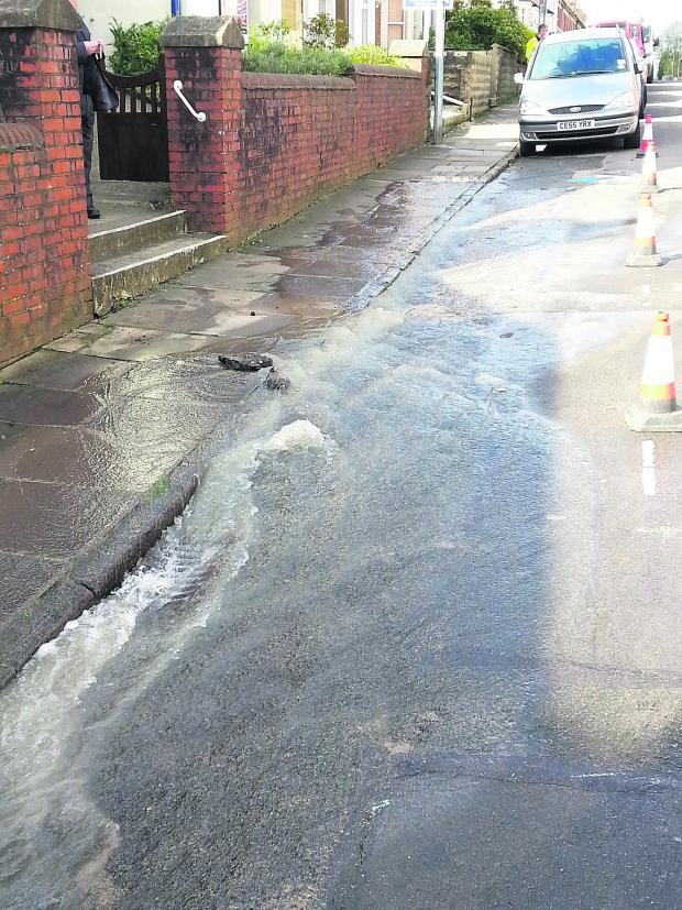 This Is Wiltshire: A burst water main flooded Dixon Street on Friday