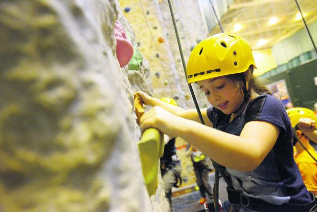 This Is Wiltshire: Isabel tackles the climbing wall
