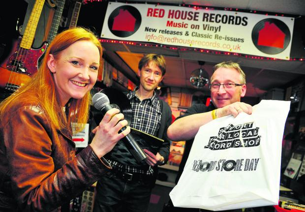 This Is Wiltshire: Singer Louise Latham, Paul Holmes and Alan Holmes at John Holmes music store