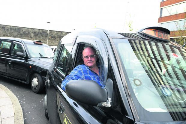 This Is Wiltshire: Taxi driver Dave Mackie outside Swindon Railway Station