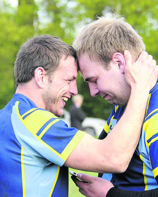 This Is Wiltshire: Barry Coombs with Lloyd Davis after the narrow victory over Guildford