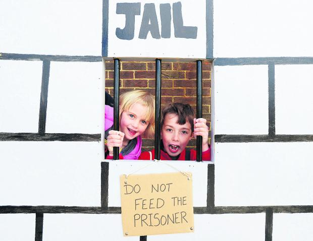 This Is Wiltshire: Daisy and Harrison on the jail photo booth at the Restore fun day