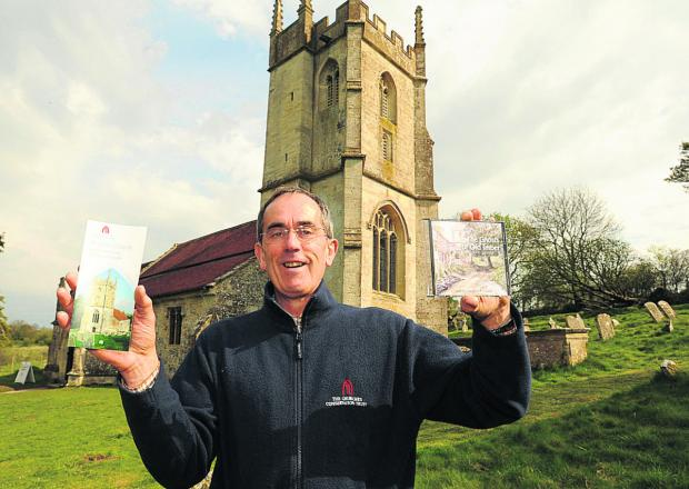 This Is Wiltshire: Neil Skelton at St Giles Church with the CD the Ghosts of Old Imber       (TP48664) By Trevor Porter