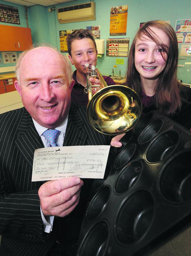 This Is Wiltshire: Angus Macpherson, treasurer of the Filling Station, with pupils George Staten and Holly Gibbs