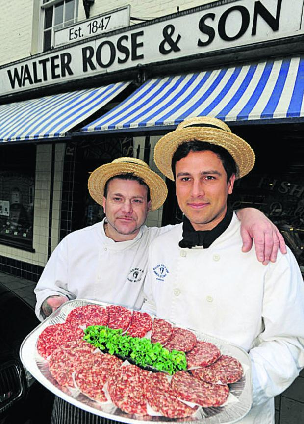 This Is Wiltshire: Paul Gilroy and Jack Cook, of Walter Rose & Son, with burgers which got to the 2012 finals of the England's Best Burger competition
