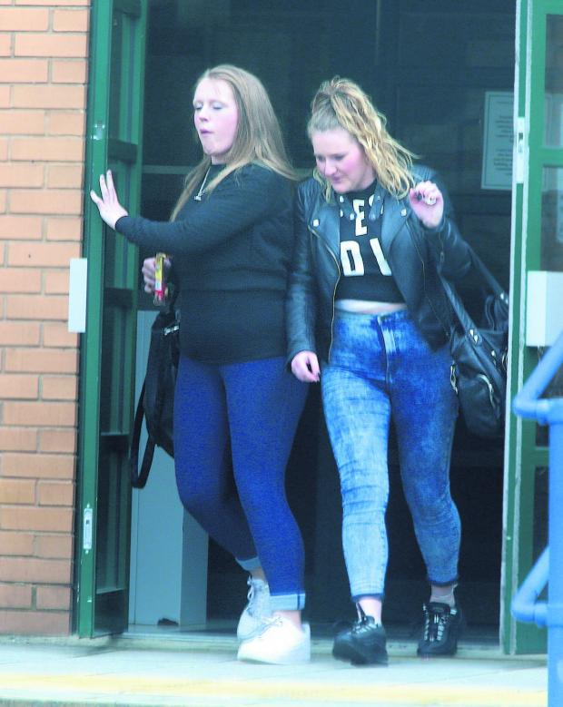 This Is Wiltshire: From left, Leanne Hurd and Helen Westall leaving Swindon Magistrate's Courts after being found guilty of having a dangerous dog which was out of control