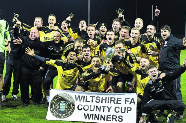 This Is Wiltshire: Melksham celebrate their cup victory last night (Picture by Diane Vose)