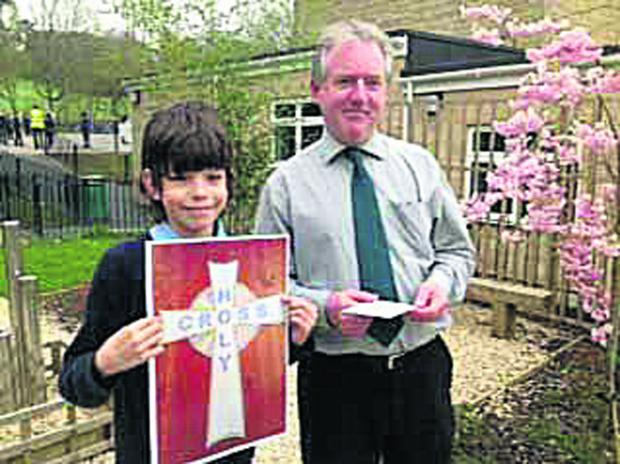 This Is Wiltshire: Samuel Garrett holding his winning design alongside headteacher Tony McAteer