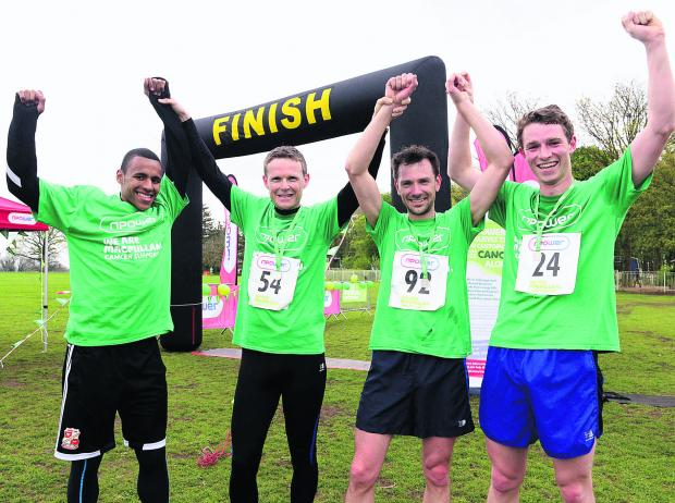 This Is Wiltshire: Nathan Thompson, far left, at the finish line with top three runners Martin Cole, Toby Erith and Edward Porter after the npower 10k race