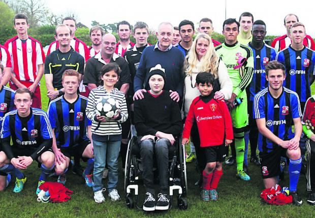 This Is Wiltshire: Ben Conolly (centre) surrounded by football players, supporters and his family