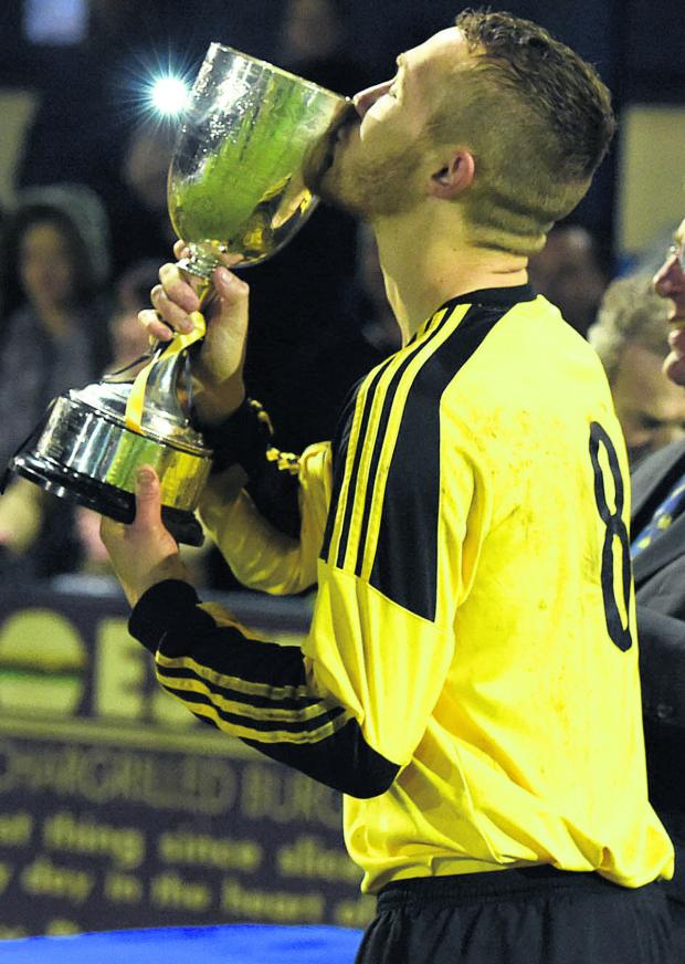 This Is Wiltshire: Melksham skipper Dave Thompson kisses the trophy