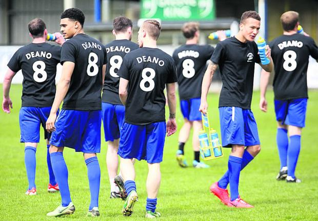 This Is Wiltshire: Chippenham Town's players wear T-shirts in support of injured teammate Rob Dean on his return to Hardenhuish Park Picture by Robin Foster