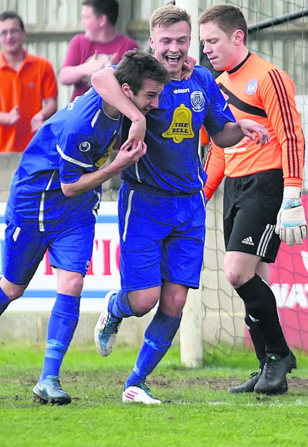 This Is Wiltshire: Jake Harris (right) celebrates his second goal against Hungerford with teammate Joe McClennan