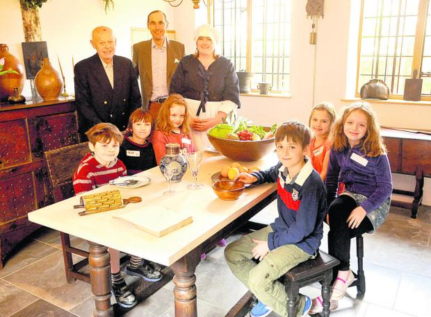 This Is Wiltshire: Richard Clapp, John Sykes and Ali Stott with visiting children                            (VS301) By Vicky Scipio