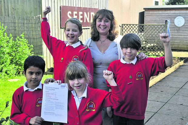This Is Wiltshire: Jackie Chalk, Seend Primary School headteacher, with head boy Harvey, head girl Anouk and pupils Mushin and Sadie who spoke to the Ofsted inspectors