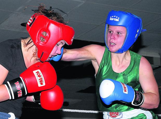 This Is Wiltshire: Emeralds' Emma Hanselman (above, green) has Swindon opponent Bronwyn Duff on the ropes on her way to her first career victory Picture by Paul Mazzotta