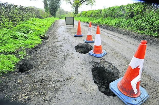This Is Wiltshire: The Corsley road which has been shut since the appearance of holes leading to a badger sett