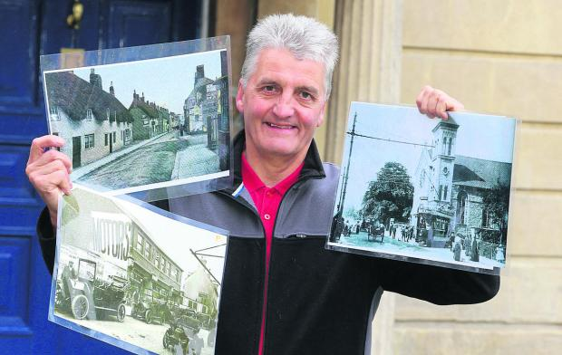 This Is Wiltshire: Andy Binks from the Swindon Society holding photographs of old Swindon which are in an exhibition