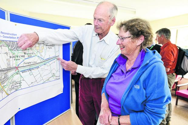 This Is Wiltshire: Richard and Judy Gosnell study plans at a public exhibition by Network Rail on the proposed changes to Templars Farm Bridge as part of the new electric line