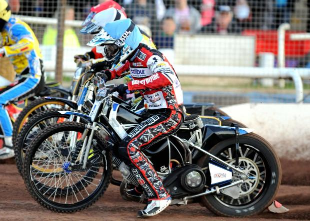 This Is Wiltshire: Action from last night's meeting between Swindon Robins and Eastbourne Eagles