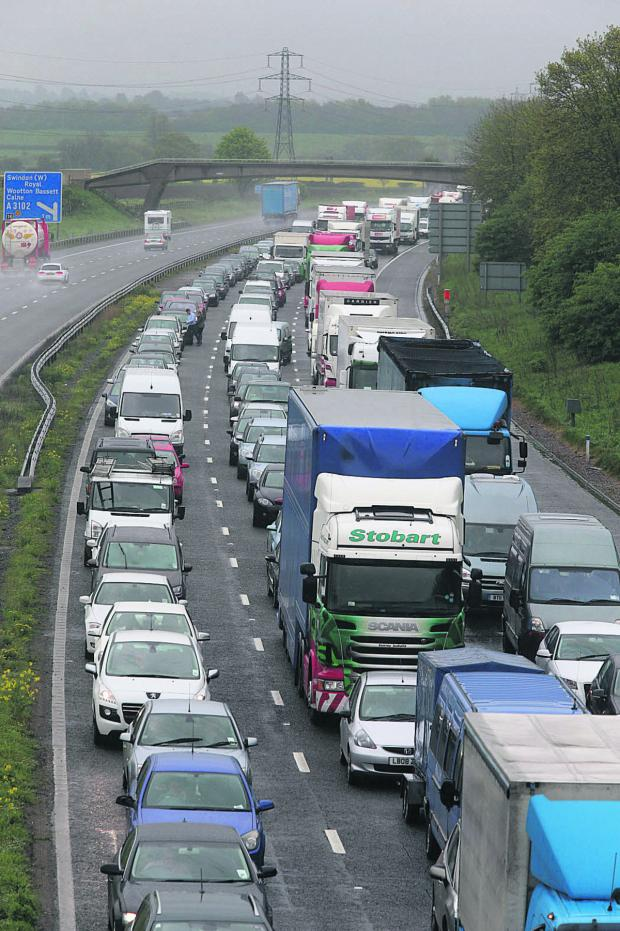 This Is Wiltshire: Going nowhere – the tailback on the M4 following yesterday morning's pile-up