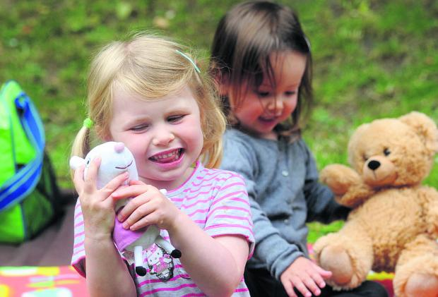 This Is Wiltshire: Alex Mayne and Mary McKay enjoy some furry fun at the teddy bears picnic at last year's festival