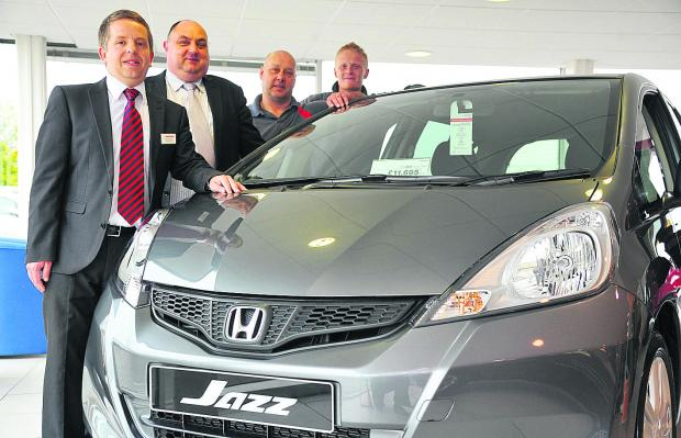 This Is Wiltshire: Kenan Harrison, sales manager at Fish Bros Honda, Bridgemead, service manager Chris Smy, Peter Hall and Paul Hill with the Jazz