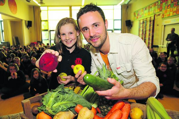 This Is Wiltshire: Red Oaks Primary School pupil Beth with Kris Talikowski from the Core Juice Bar during a demonstration of healthy eating
