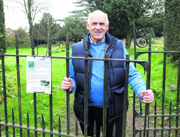 This Is Wiltshire: Councillor Stewart Dobson uncovered a hidden grave bearing his family name during a community clear-up project in Marlborough's old cemetery. (VS309) By Vicky Scipio