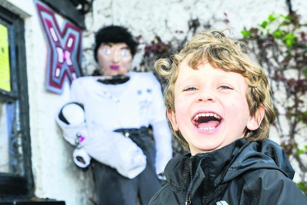 This Is Wiltshire: Teddy Loxley has a laugh on the Wanborough Scarecrow Trail