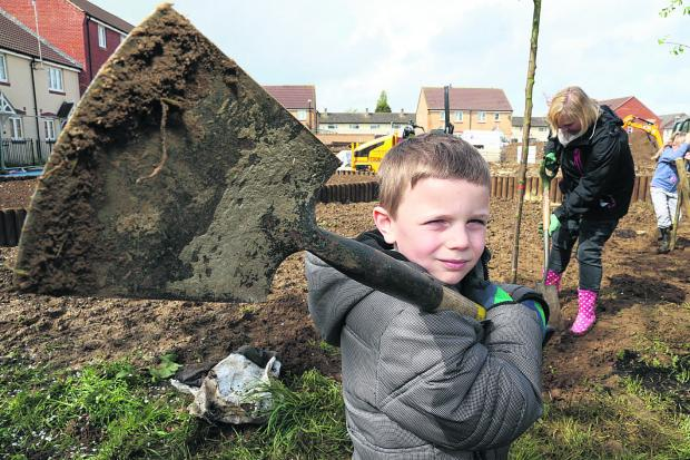 This Is Wiltshire: Six-year-old Luca Mikeli with his mother Julie at the tree planting  near Cavendish Square
