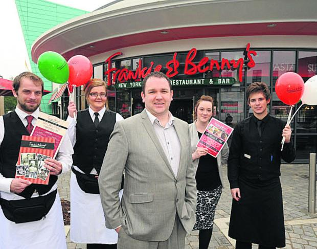 This Is Wiltshire: Manager James Bird with, from left, Stuart Taylor, Zara Windsor, assistant manager Jo James and Luke Taylor at Frankie and Benny's restaurant on the St Stephens Leisure Park. (TP48702) Picture by Trevor Porter