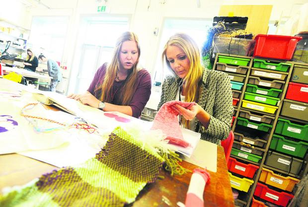 This Is Wiltshire: Student Renate Bleek and practical course leader Natalie Adamson-Wain in the textiles department. Picture: THOMAS KELSEY