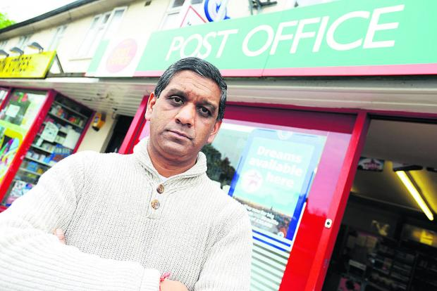 This Is Wiltshire: Atul Patel outside Moredon Post Office which was robbed last week. Picture: THOMAS KELSEY