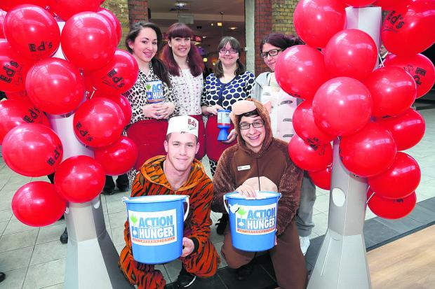 This Is Wiltshire: The Ed's Diner staff dressed in onesies for Action Hunger, back row, from left, Beth Cooper, Clare Jefferies, Zoe Stacey and Kaya Cowan, and front, Matthew MacDonald and Daniel Oliver