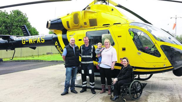 This Is Wiltshire: Phil Harding, Officer Kevin Reed, Kate Harding, Alex Freestone and Michelle Agostino alongside the Air Ambulance