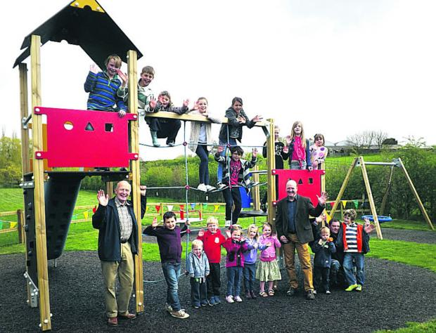 This Is Wiltshire: Coun Philip Whitehead, right, opens the Easterton play area with village children and parish council chairman Chris Saunders