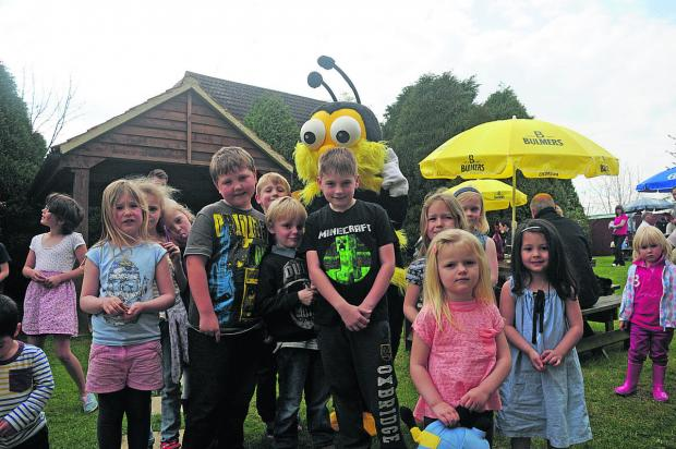 This Is Wiltshire: Busy the Bee helped this group of children solve the clues to find delicious eggs at Southwick.
