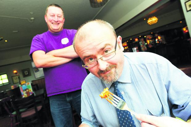 This Is Wiltshire: Barrie Hudson about to tuck into his Hot As Hell curry, with a sadistic Karl Willcox looking on