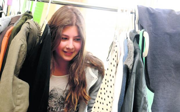 This Is Wiltshire: Sophia Khan checks out the clothes rail at Savernake Street Social Hall free shop