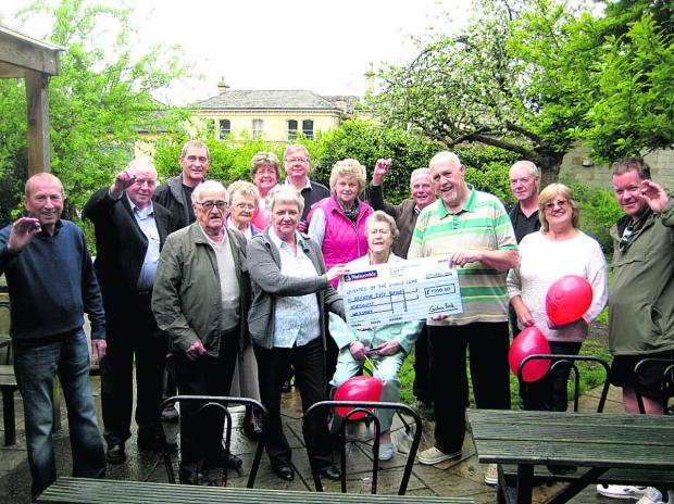 This Is Wiltshire: Dinny Treacy presents the cheque on behalf of the Winkle Club to Val Scruse of Breathe Easy