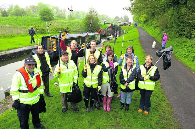 This Is Wiltshire: Volunteer lock keeper David Ball, left, with staff from M&S 	              (PM1217) By Paul Morris