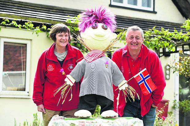 This Is Wiltshire: Ros Pendry and chairman Rob Pendry with a scarecrow they have made for the festival 								 (DV1279) By DIANE VOSE