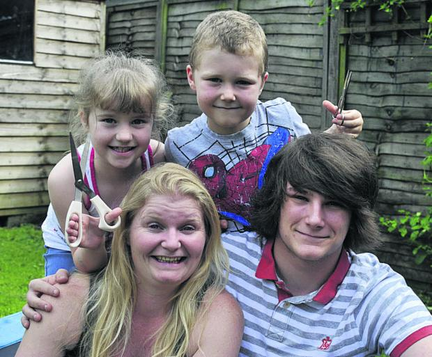 This Is Wiltshire: Abbie Wheeler and her eldest son Jean-Luc with Sam, who has epilepsy, and his sister Danielle