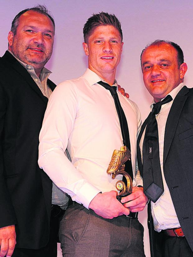 This Is Wiltshire: Bradford Town hotshot Sam Jordan scooped the top awards at the club's presentation evening and sportsman's dinner last week. Jordan (middle) is pictured with former Liverpool defender Neil Ruddock (left) and manager Paul Shanley