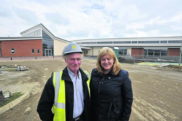 This Is Wiltshire: Headteacher Tracy Boulton with construction site manager Mike Gough at Trowbridge school Castle Mead Primary
