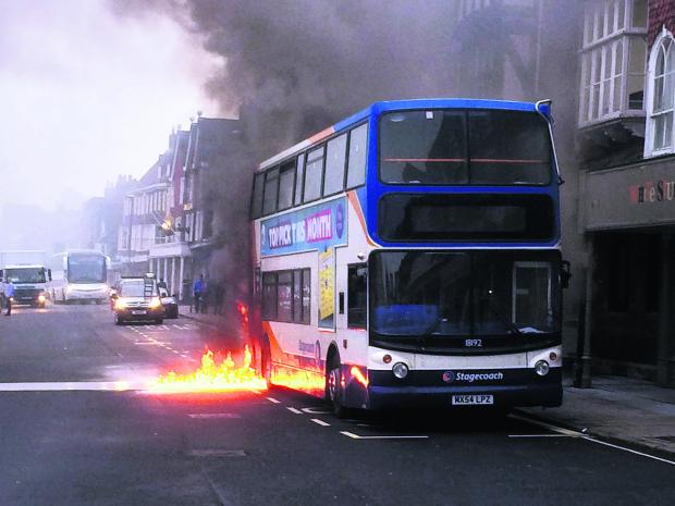 This Is Wiltshire: The dramatic scene of the bus fire